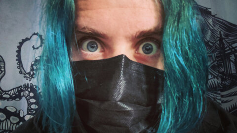 Christopher long-haired selfie in mask mode