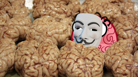 Jar brain hiding behind a Fawkes mask in a crowd of brains