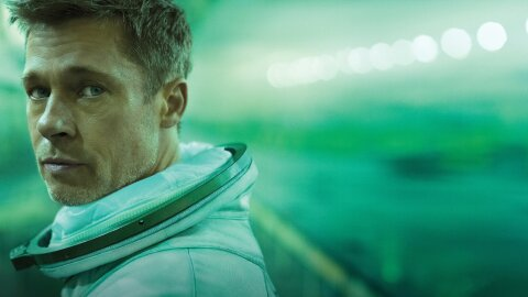 Spaceman Brad Pitt on an artful soft green background
