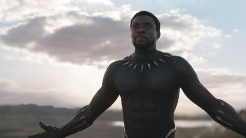 Black Panther, his arms wide.