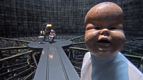 Creepy baby torture mask Brazil movie backdrop