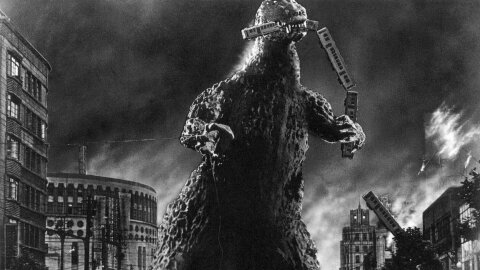 Godzilla smashing a city in Japan black & white movie backdrop
