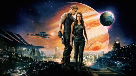 Channing Tatum and Mila Kunis standing in front of Jupiter (and Earth somehow?) movie backdrop