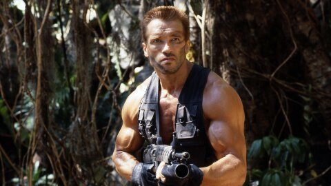 Arnold looking very manly with a grenade launcher