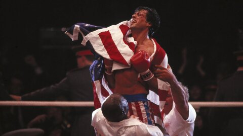 Rocky, morally victorious, draped in the American flag