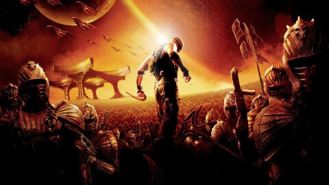 Riddick standing dramatically over an army of Necromongers