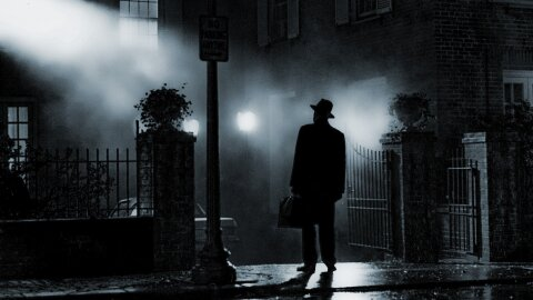 Priest standing on a misty night Exorcist movie backdrop