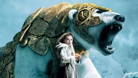 Little girl standing with a warrior polar bear in totally sweet golden armor Golden Compass movie backdrop