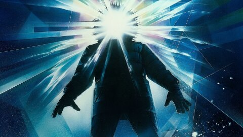 Snow-suited man with light exploding from face The Thing movie backdrop