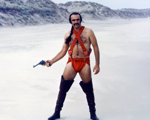 Shaun Connery in an amazing red bandolier/codpiece get-up, brandishing a pistol