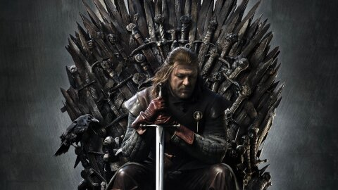 Eddard Stark sitting solemn on the Iron throne